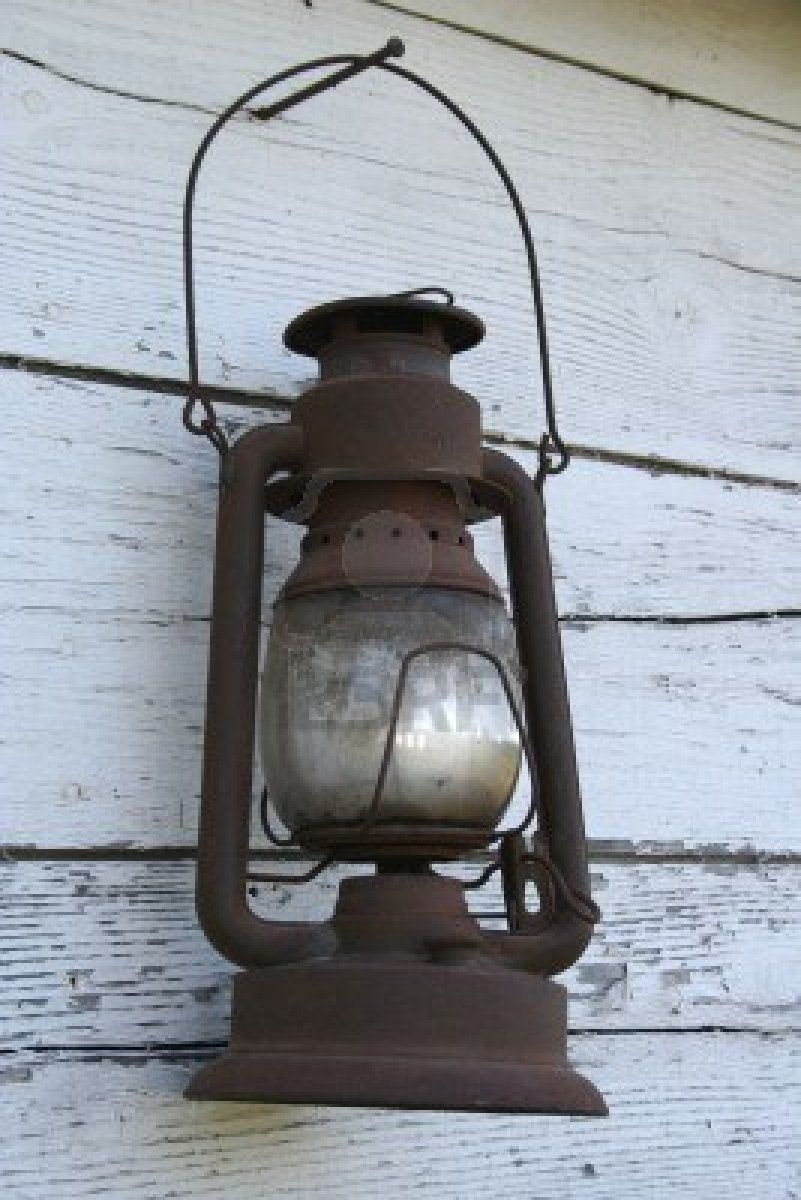 Old lantern vintage look pinterest oil lamps rustic lamps and old rusted antique lantern hanging on barn wood used these to brighten up your christmas lighting arubaitofo Gallery