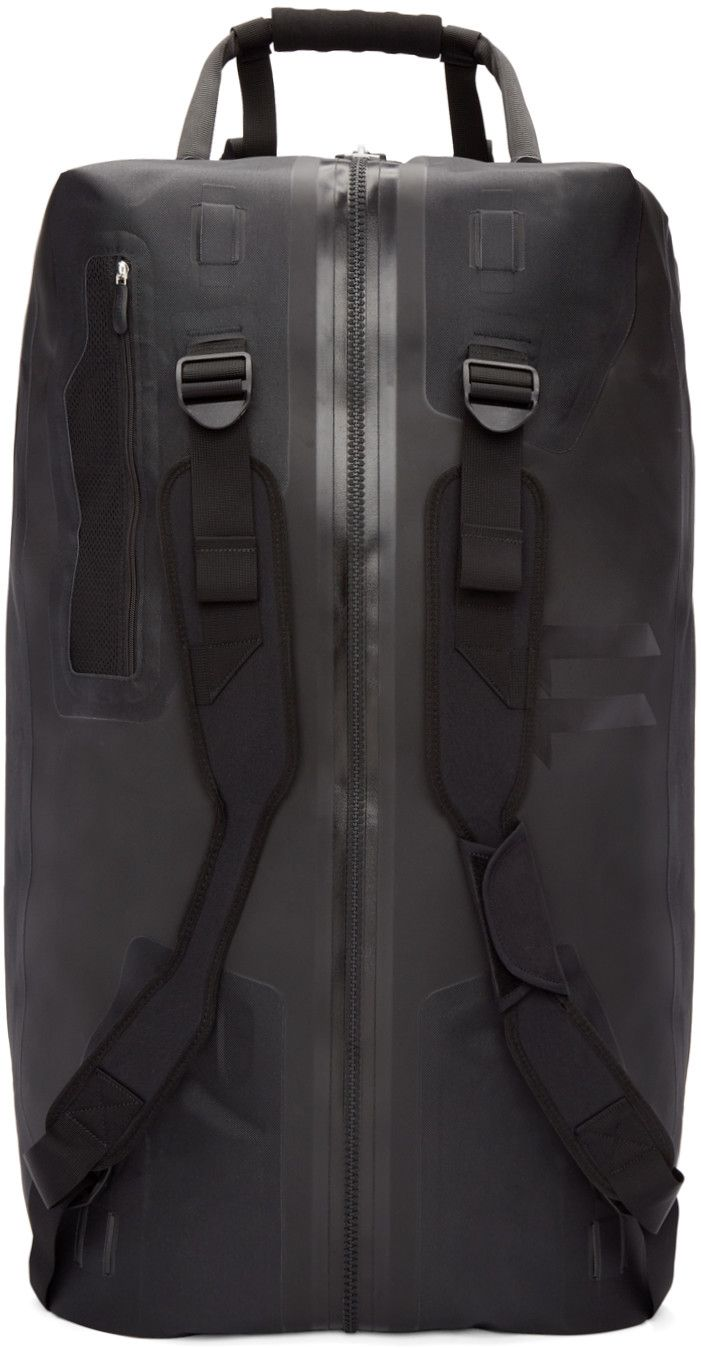Polyurethane duffle bag in black. Carry handle at top and