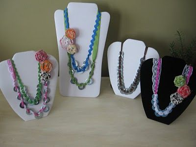Washer necklaces with misc. ric rac and trims, added fabric rosette pin
