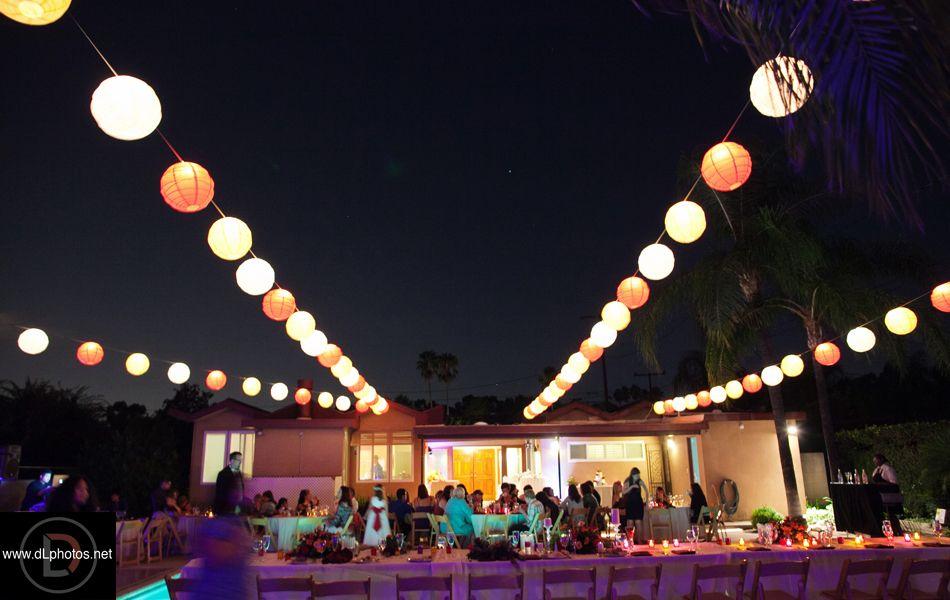 night time photo of backyard and tea lights