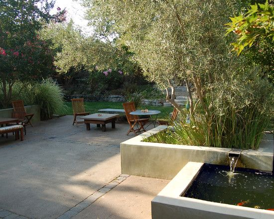 Patio Design With Wooden Arm Chair And Concrete Pond For Koi Fish:  Interesting Ideas