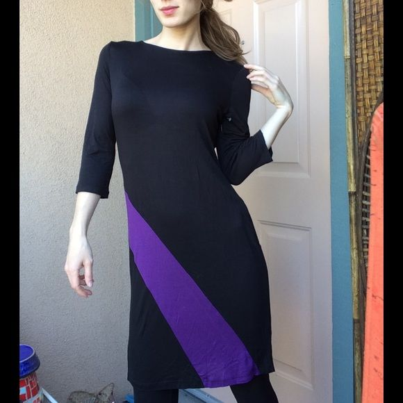 Paul Stanley Asymmetrical Purple Stripe Tunic Top 3/4 sleeve. Excellent condition. Smoke free home. Not worn. No stains rips or tears. Diagonal Stripe. Color clock. Color blocking. Designer. Artist. Professional. Business attire. The fabric is 92% rayon and 8% spandex. Made in USA. Could be worn with leggings and boots. Light weight. Breathable. Classy. Chic. PAUL STANLEY Dresses Long Sleeve