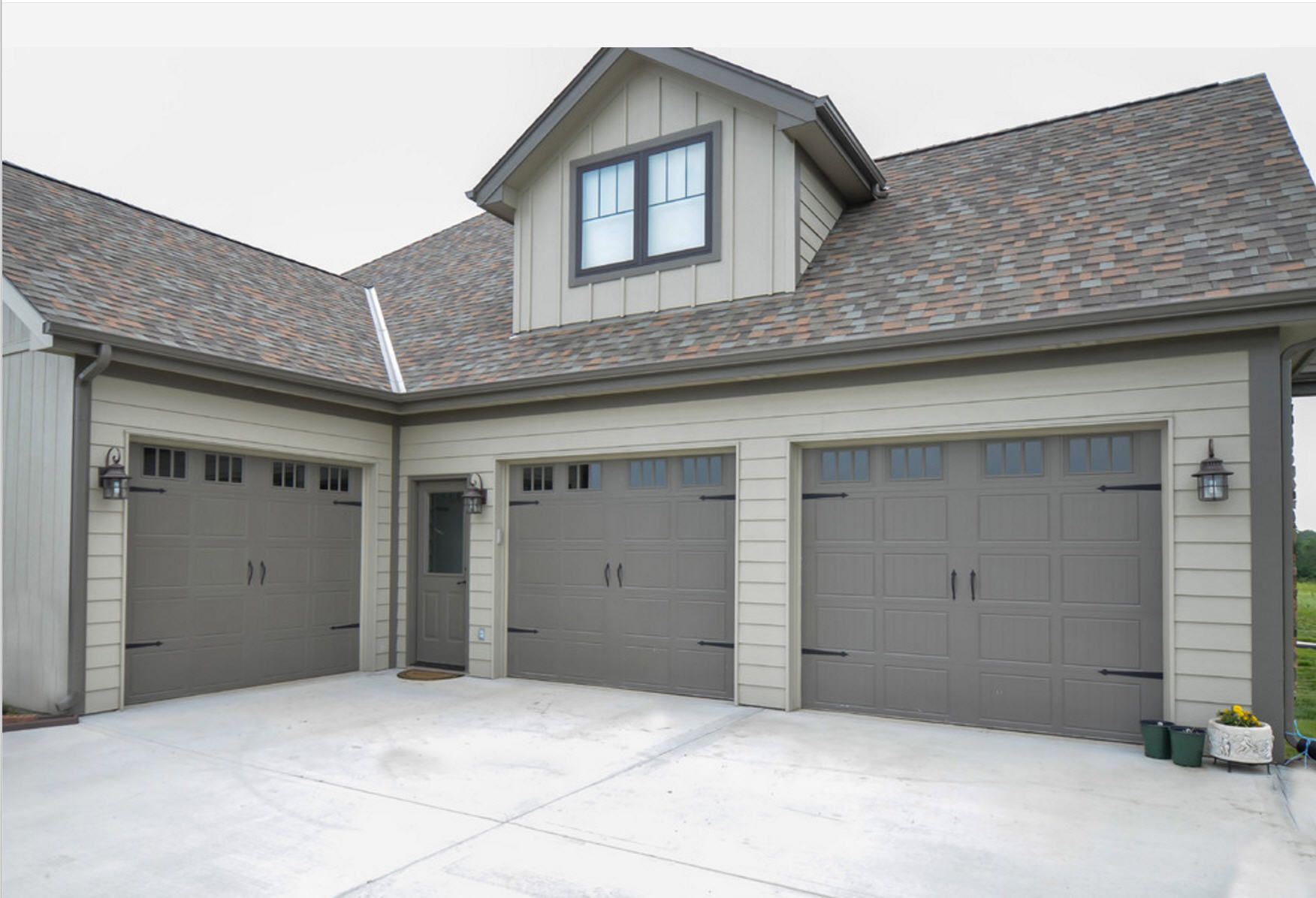 The exterior walls are intellectual gray sw 7045 and the trim is porpoise sw 7047