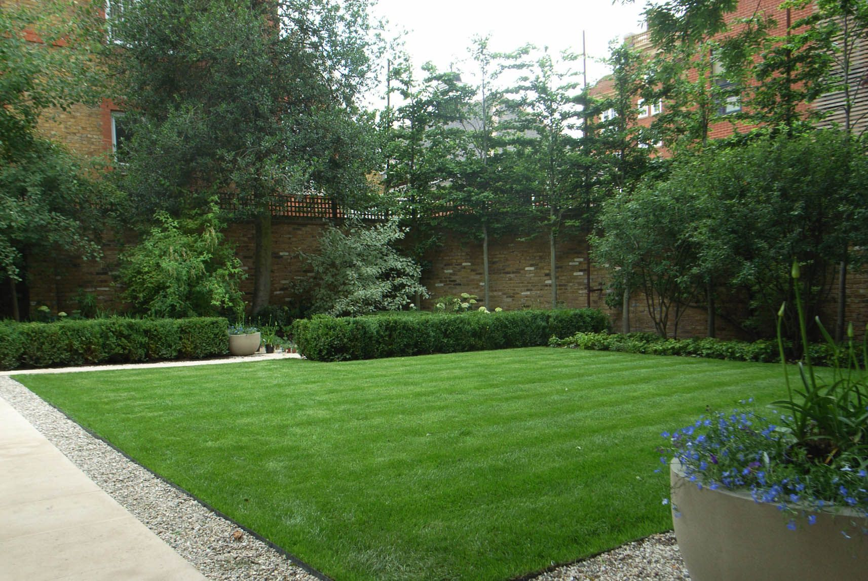 Large square lawn with asymmetrical edge planting adding ... on Square Patio Designs  id=16301
