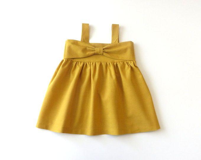 b2ffcbfda9641 Moutarde jaune Bow Dress - robe de bébé