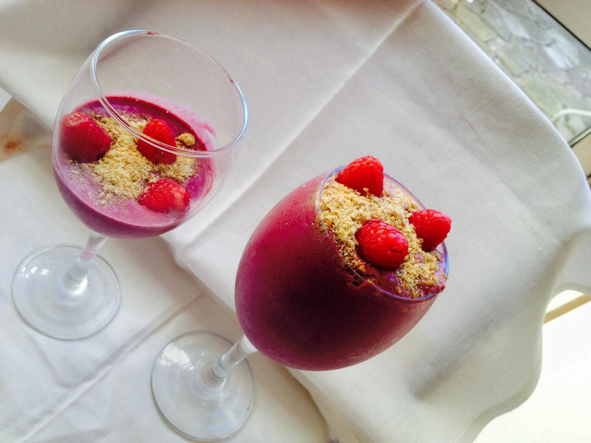 Strawberry smoothie topped with ground flaxseed