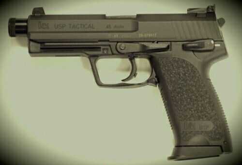 HK USP  45 Tactical with extended barrel, threaded for sound