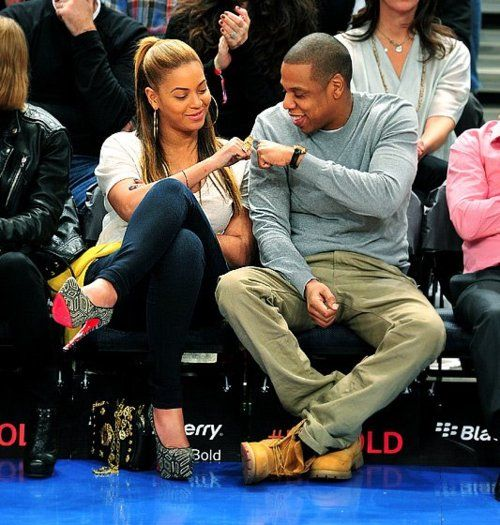 Beyonce and Jay-Z give each other a fist pound. They are pretty much perfect.