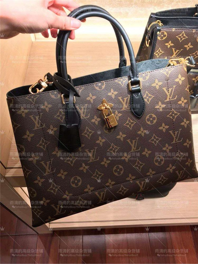 844c925c9a53 Louis Vuitton Monogram Flower Padlock Tote Bag M43550 Noir is embellished  with a distinctive Monogram Flower padlock  louis  vuitton  m43550  lv  m53550 ...