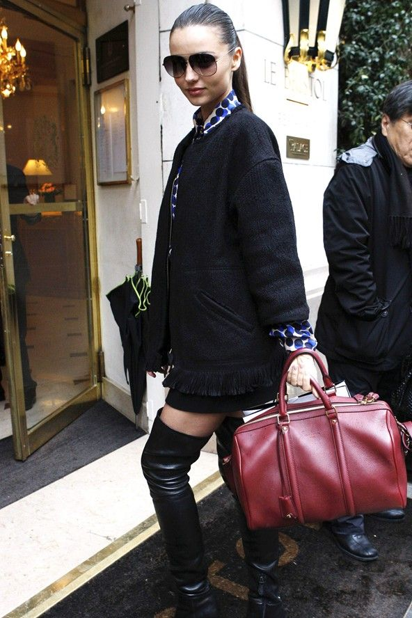 March 6 2012 Arriving at a Paris hotel in over-the-knee boots, Dita sunglasses and a short black coat.