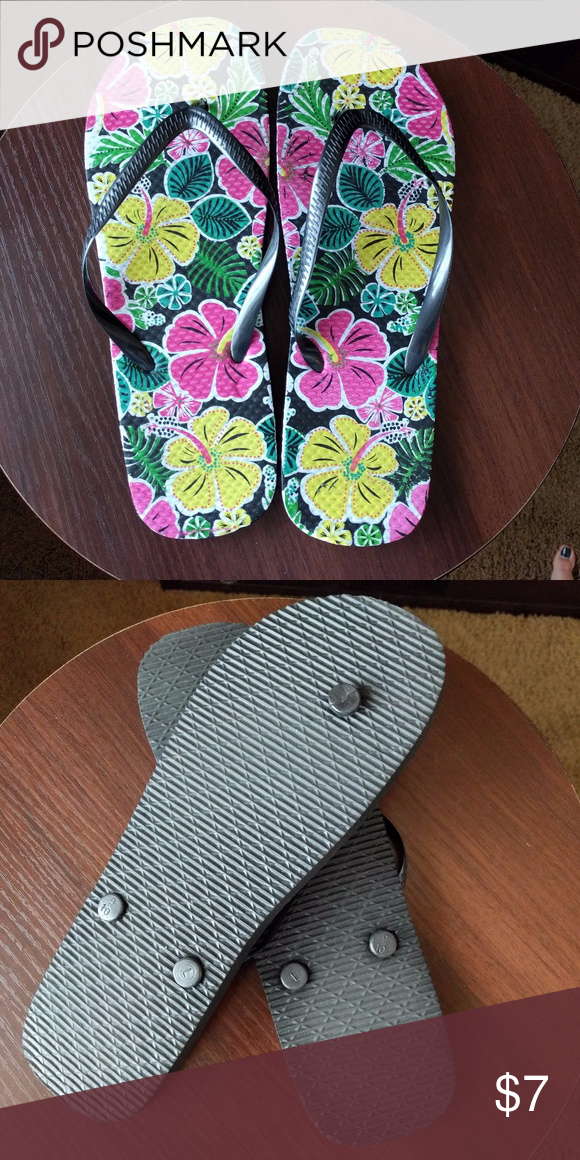 aec400ba976c0d Floral flip-flops NWOT Rubber flip-flops with cute floral Hawaiian print  and black straps. New without tags. Shoes Sandals