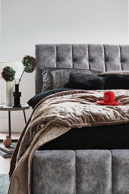 Stylish detailing and plush fabric make the Antigua bed