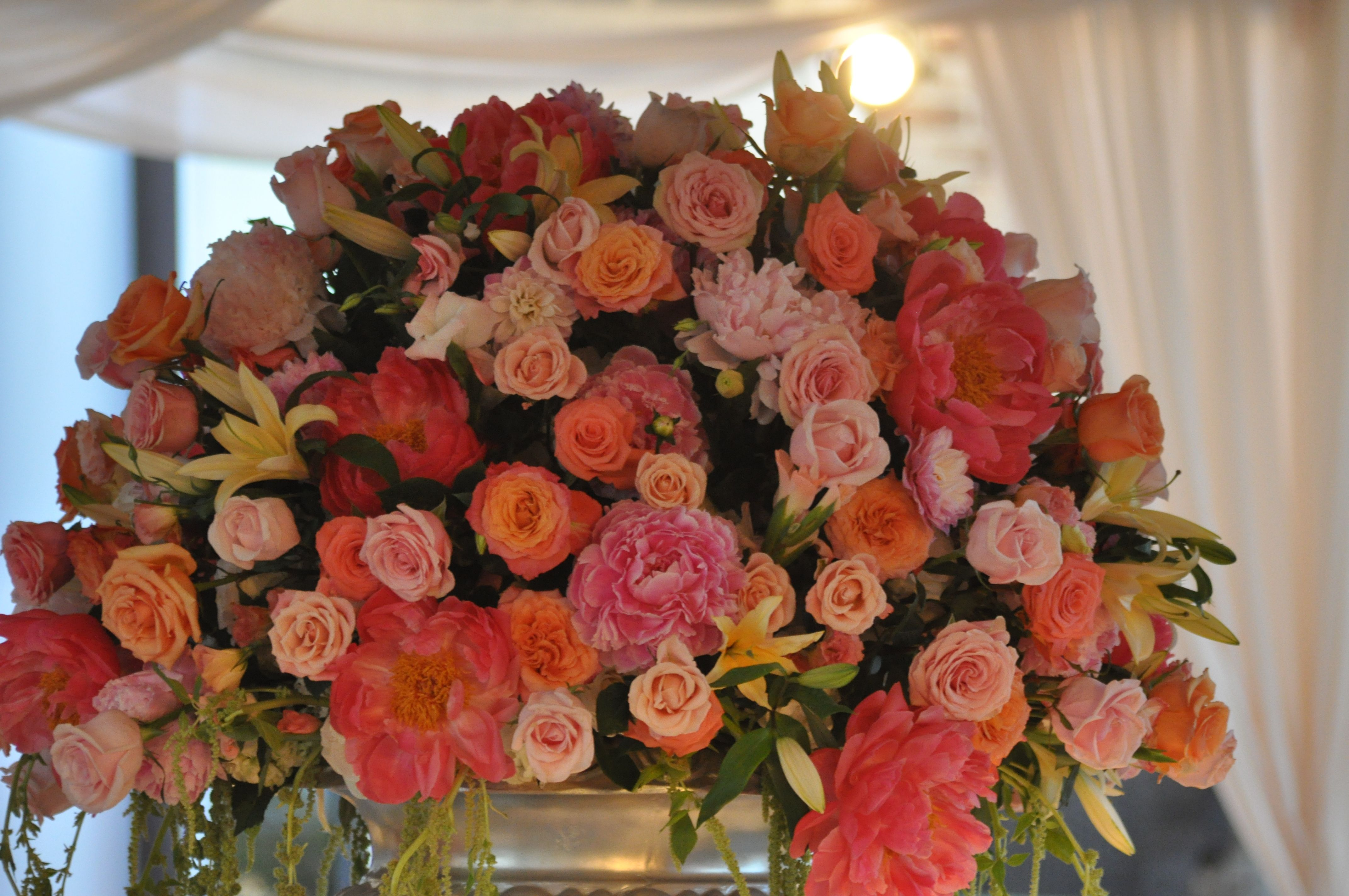 Reuse alter flowers for a statement center piece at the