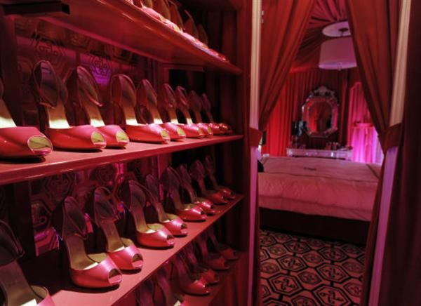Pink walk-in closet for shoes. Every girly girl's must have.
