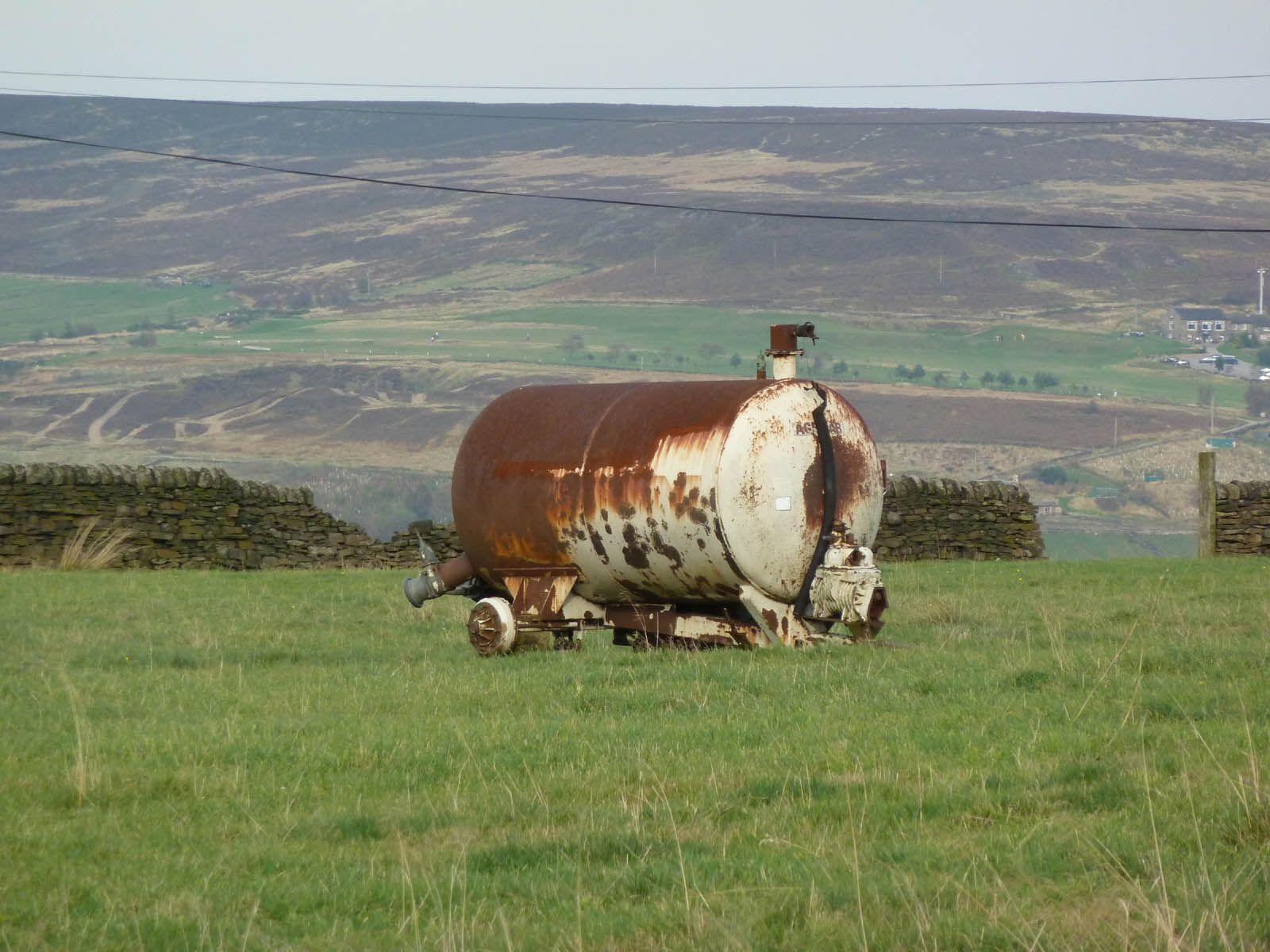 Muck spreader, gently rusting on Pennine hills.