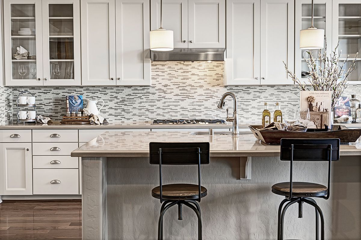 This Eye Catching Las Vegas Nv Kitchen Boasts Neutral Cabinets With Glass Panels A Decorative