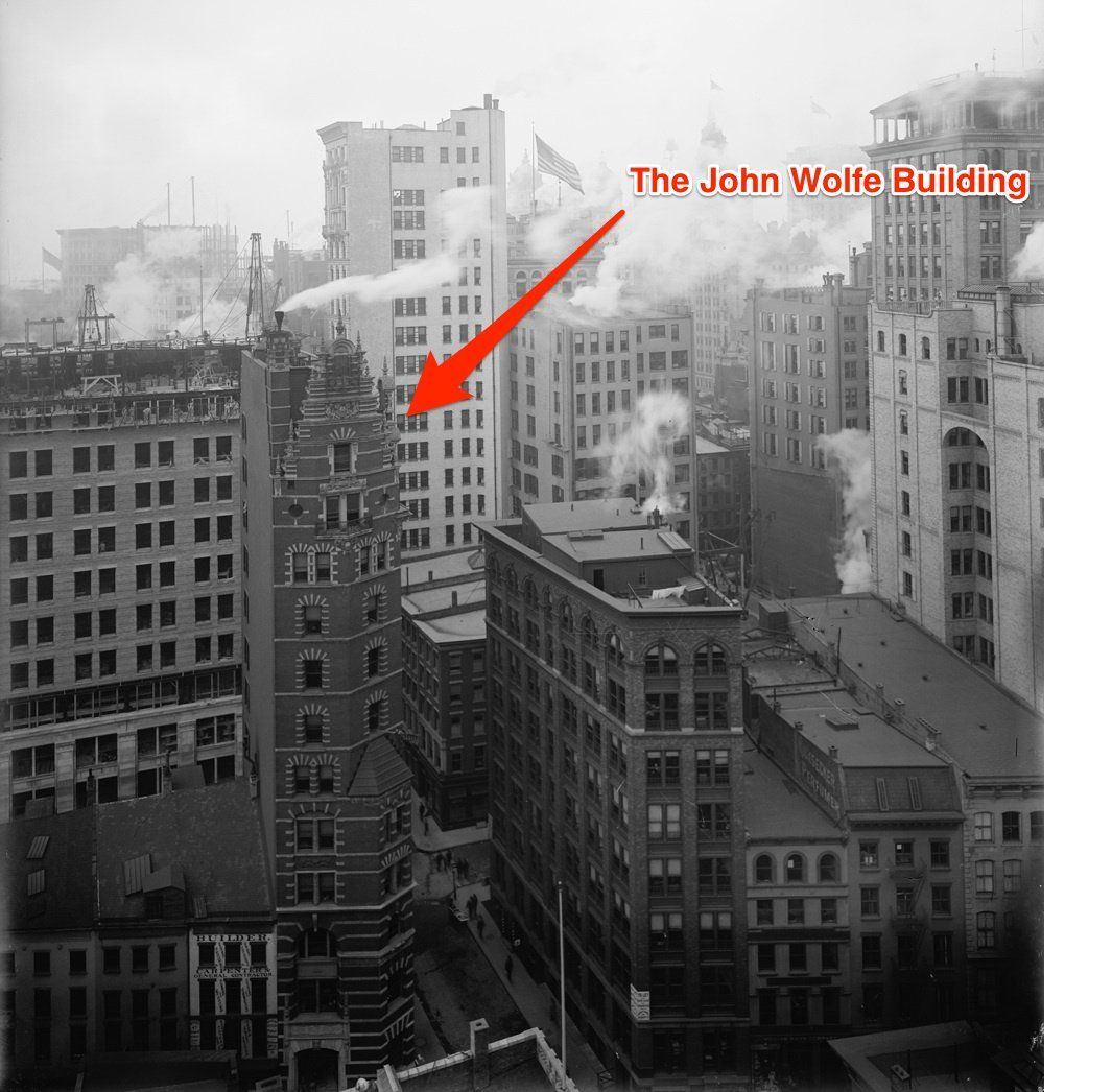 The John Wolfe Building was built in 1895 in the Financial District. It was demolished in 1974 to widen the street.
