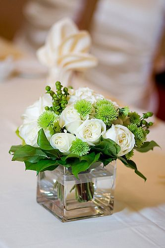 DIY Rose Centerpiece You Will Need A Cube Vase Short White Roses Green Carnations And Greenery Lots Of Other Cheap Centerpieces