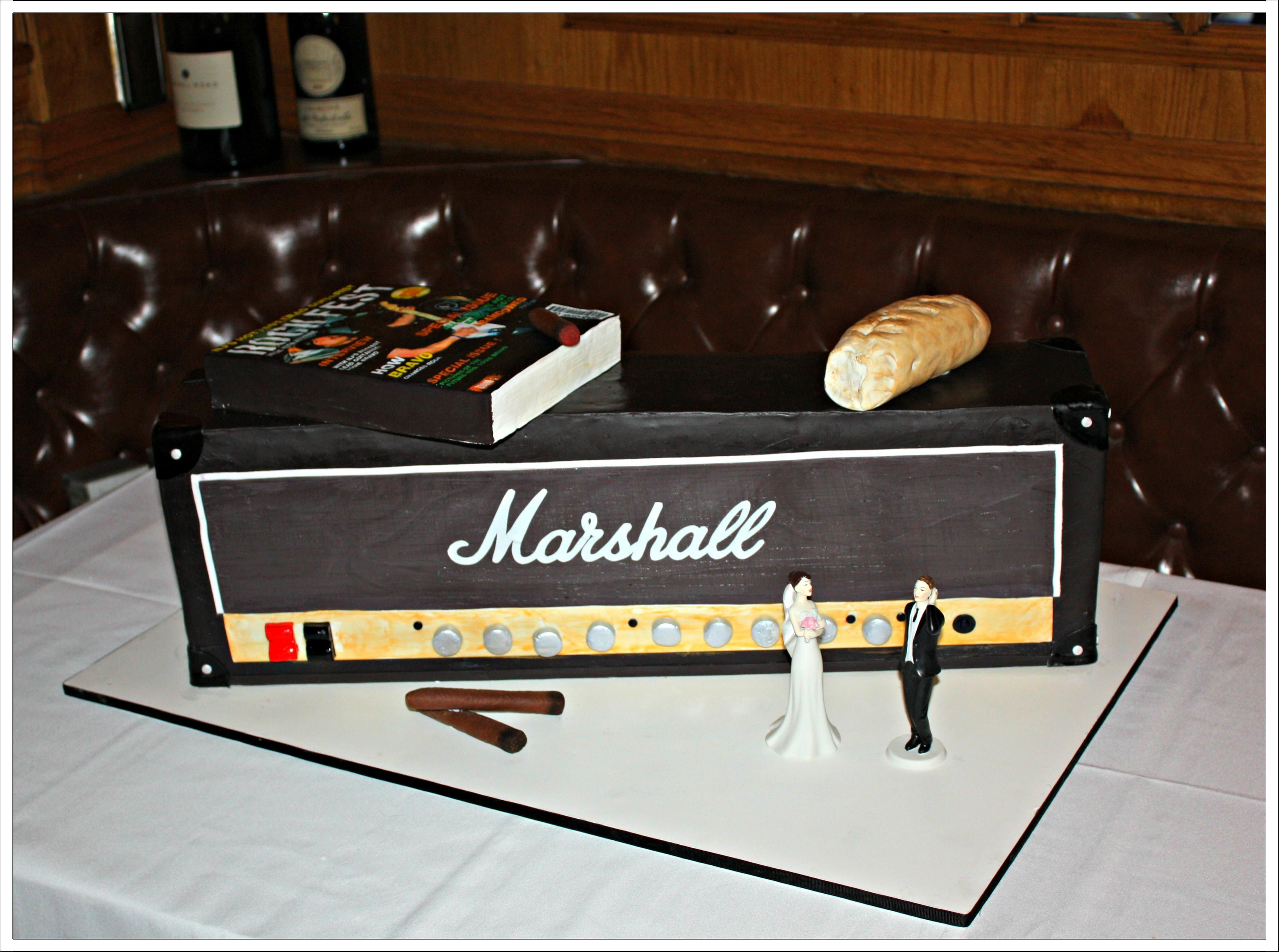 Marshall Amp Cake with edible magazine, cigars, and loaf of bread.  http://www.acakedream.com