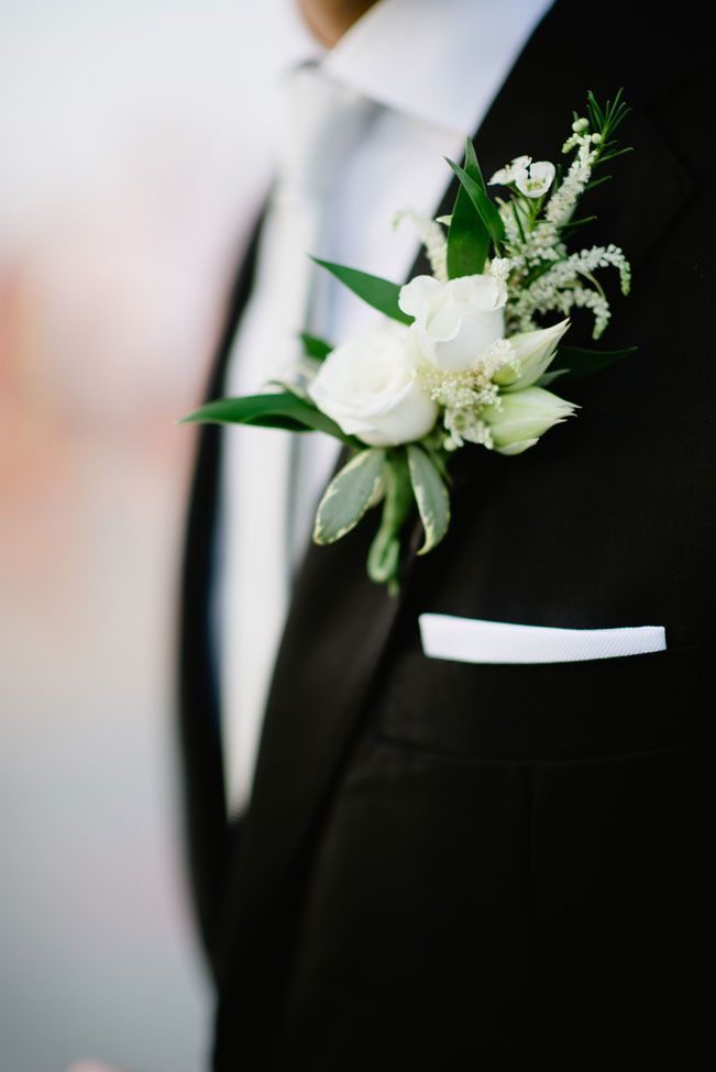 deco productions simple white boutonniere glamorous seaside wedding in champagne