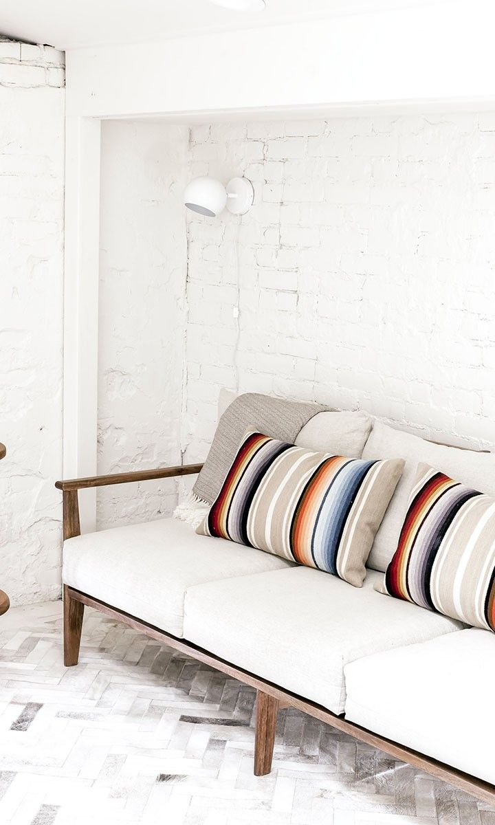 Master the art of color with this mid-century modern pillow