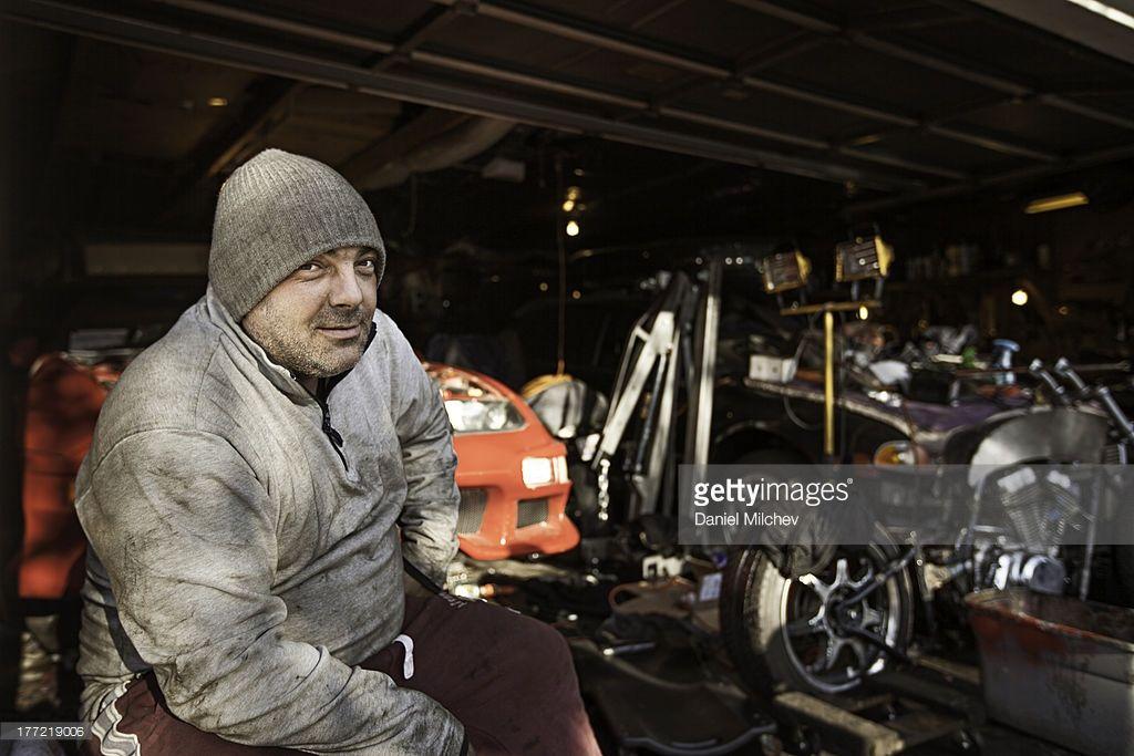 Stock Photo Car mechanic in his