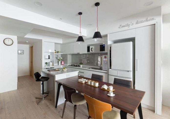 interior design studio alphonso ideas helped the homeowner to maximise the available space in his new apartment by creating an open kitchen in her living