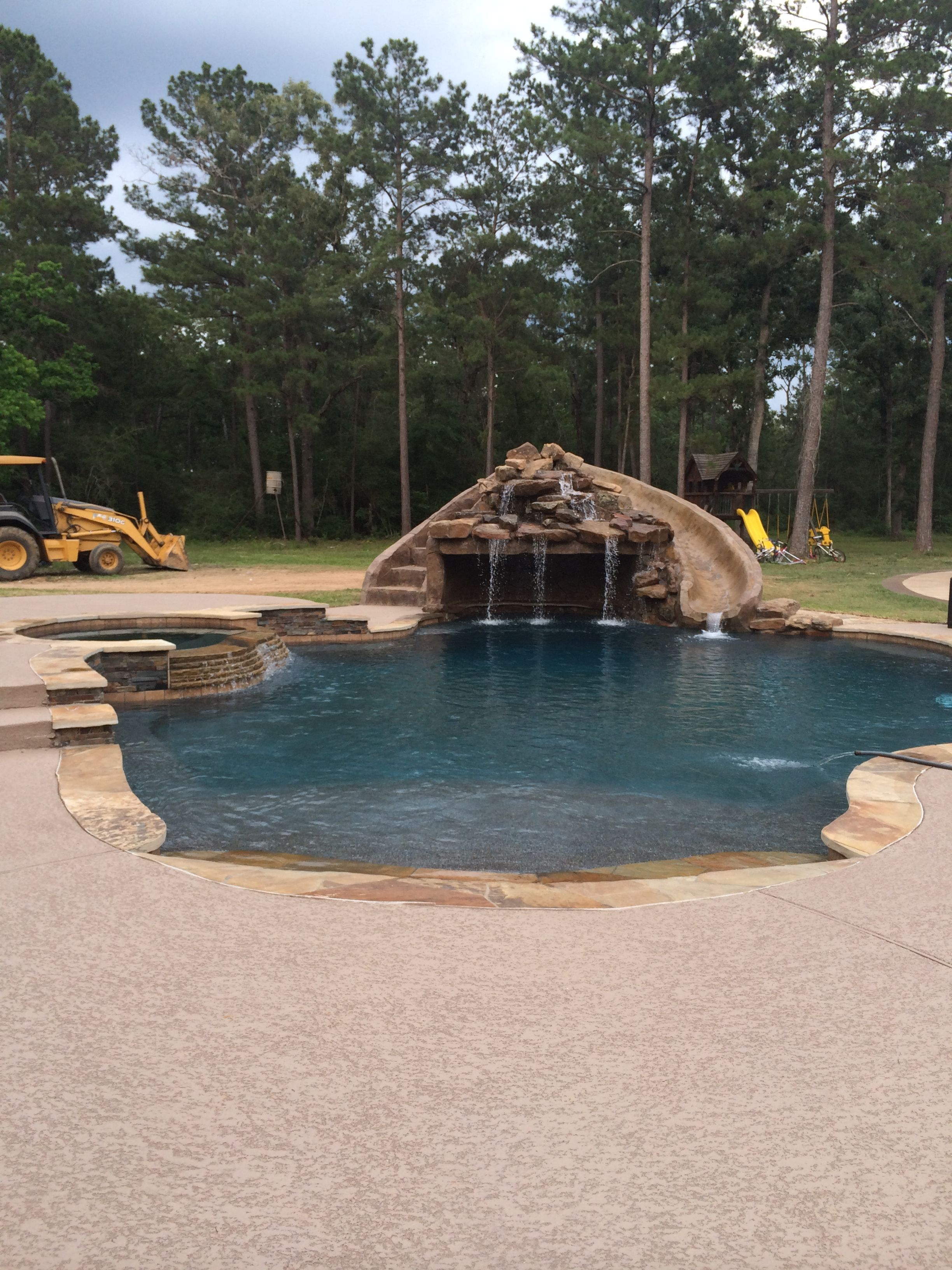 Inground swimming pools slide grotto pools by mitchell for Swimming pool grotto design