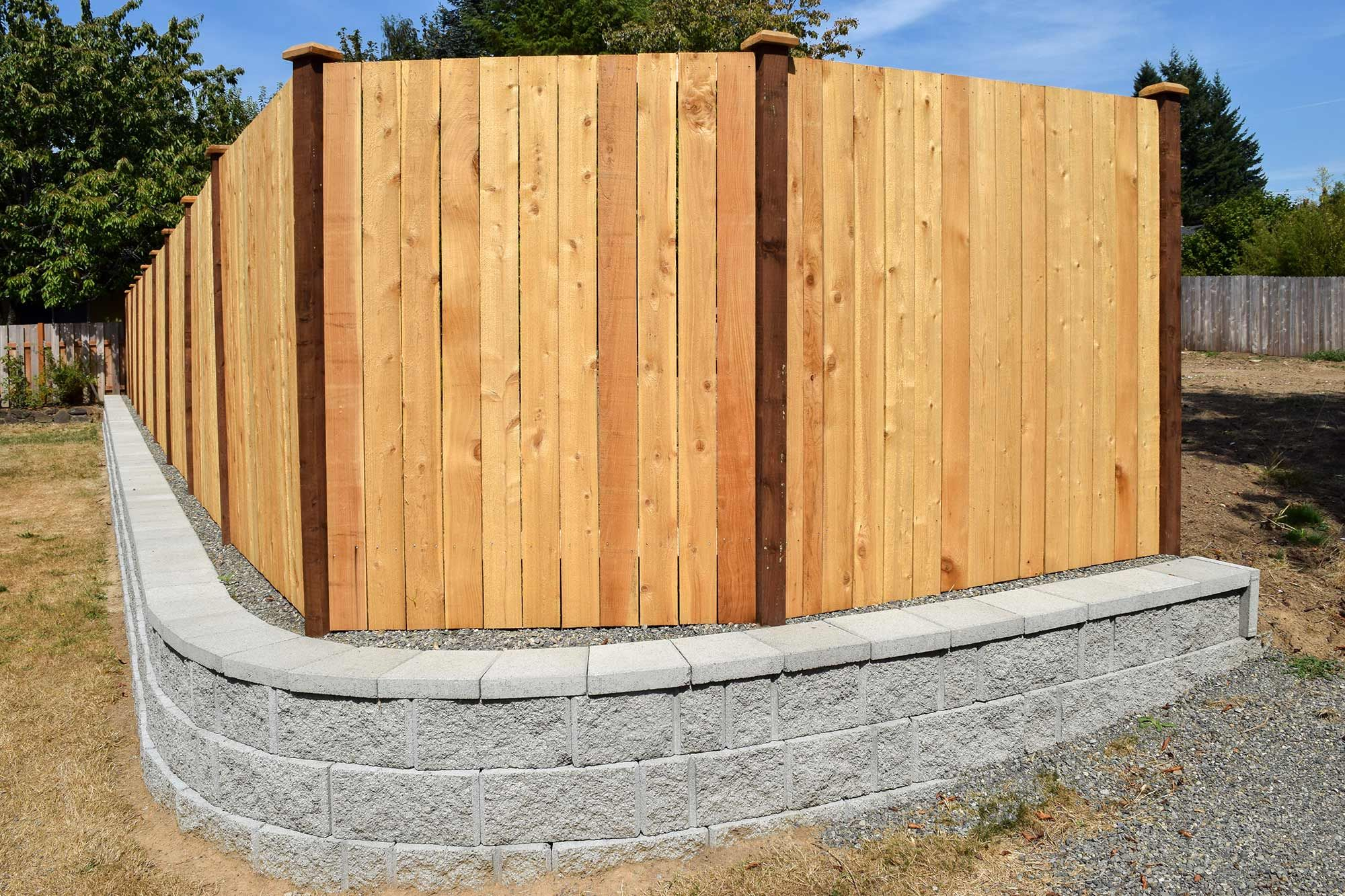 Adding this wraparound to the retaining wall makes the barrier more ...