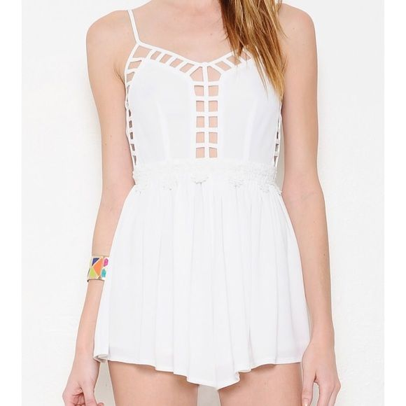 ebbf04467dd White cutout romper Fun white cutout romper with daisies lining the waist.  It gives off