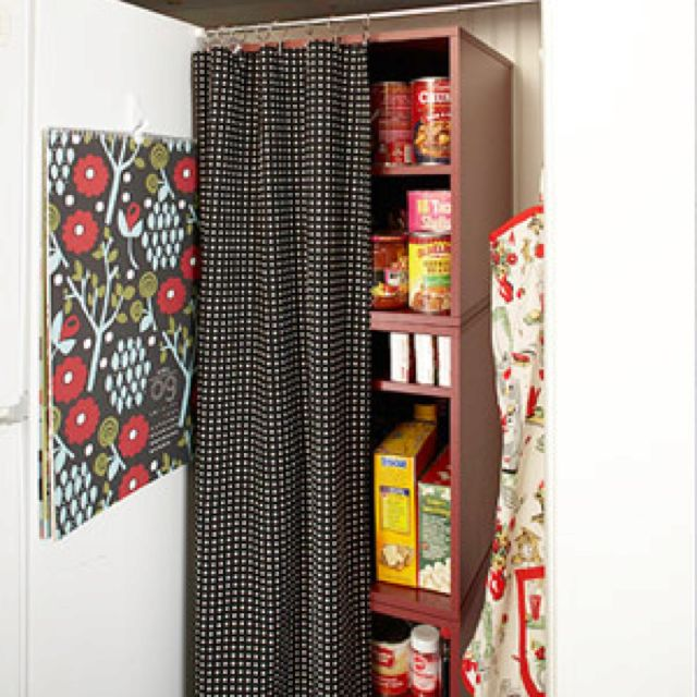 No pantry? No problem. Designate a niche next to your refrigerator as food staple central. Fill the space with shelves (a bookcase works well) and hang a tension curtain rod between the wall and the refrigerator, decked out with a curtain to match your kitchen decor.
