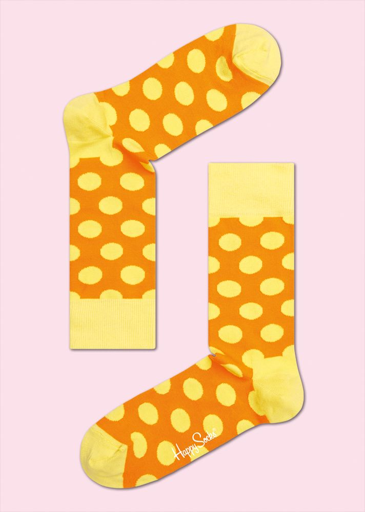 BIG DOT: Playful · Vivid · Strong. Both women and men look great in big dot socks with a yellow background. The orange wrap on the yellow spots give these socks distinct character. Add in coziness and snugness, and big dot socks quickly become a favorite. Discover the warmth and comfort of combed cotton spun from the strongest materials. COMPOSITION: 80% Combed Cotton, 17% Polyamide, 3% Elastane. www.HappySocks.com