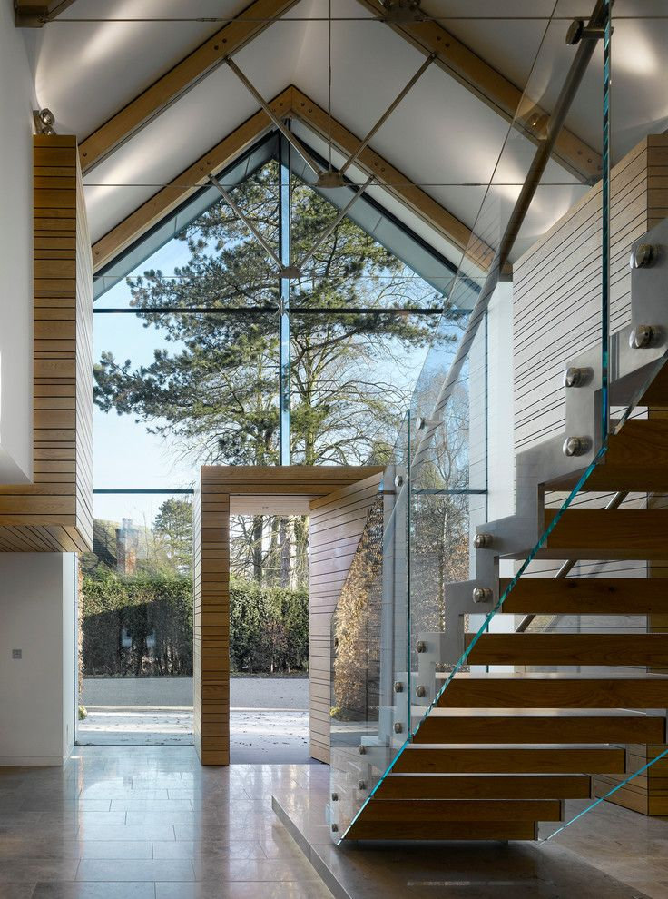 Glass house with architectural cathedral ceiling for Modern house stairs