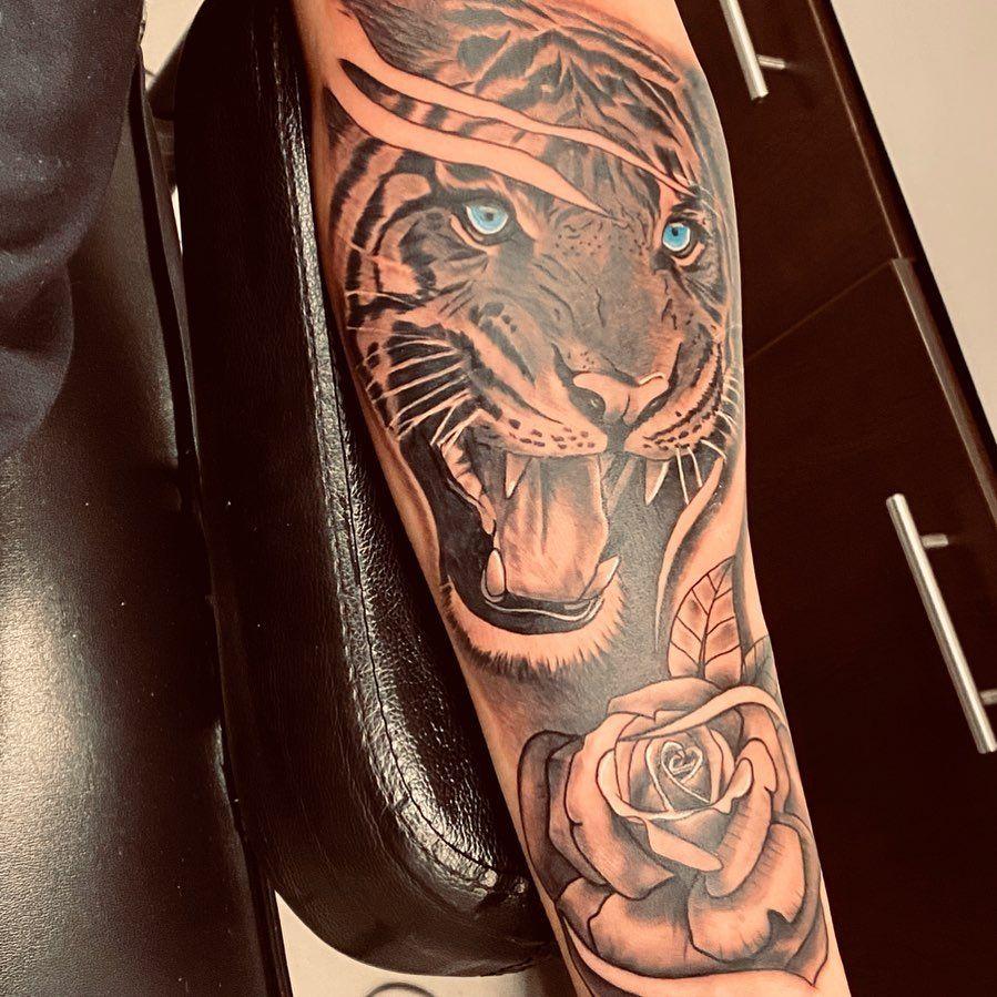 """Kimberely Estes's Instagram post: """"Gavin's 1st Tattoo #freshink #tigertattoo #inktattoo #tattoo #inkaddict #3rdgenerationink #tiger #inkedtattoo #rosetattoo #ink #inkart…"""""""