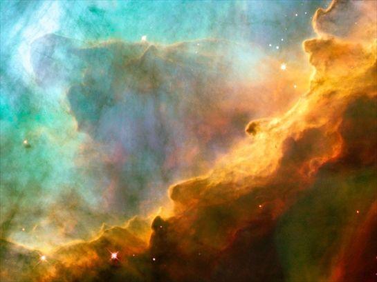 La nebulosa Omega (chiamata anche M17).I colori presenti in questa nube di gas ne rivelano la composizione chimica: il verde corrisponde alla presenza di idrogeno , il rosso e il blu rispettivamente a quella di zolfo e ossigeno. - The Omega Nebula (also called M17). Colors in this gas cloud reveal the chemical composition: green corresponds to the presence of hydrogen, red and blue respectively to that of sulfur and oxygen.