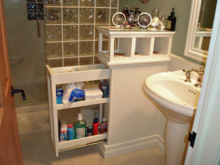 instead of an empty half wall in a bathroom install a pull out shelf in it our bathrooms in. Black Bedroom Furniture Sets. Home Design Ideas