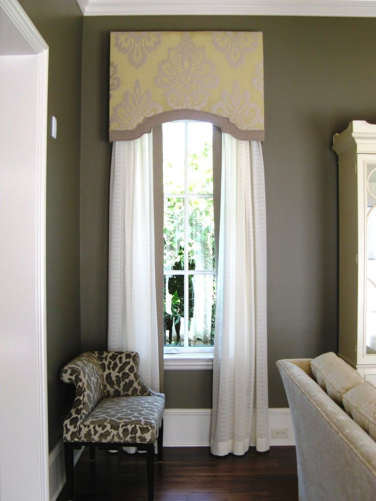 Love the cornice box with the matching edging on the white sheer curtains