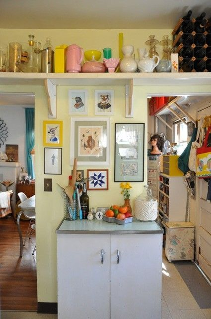 High shelf adds extra storage to this tiny home 39 s kitchen for Extra kitchen storage