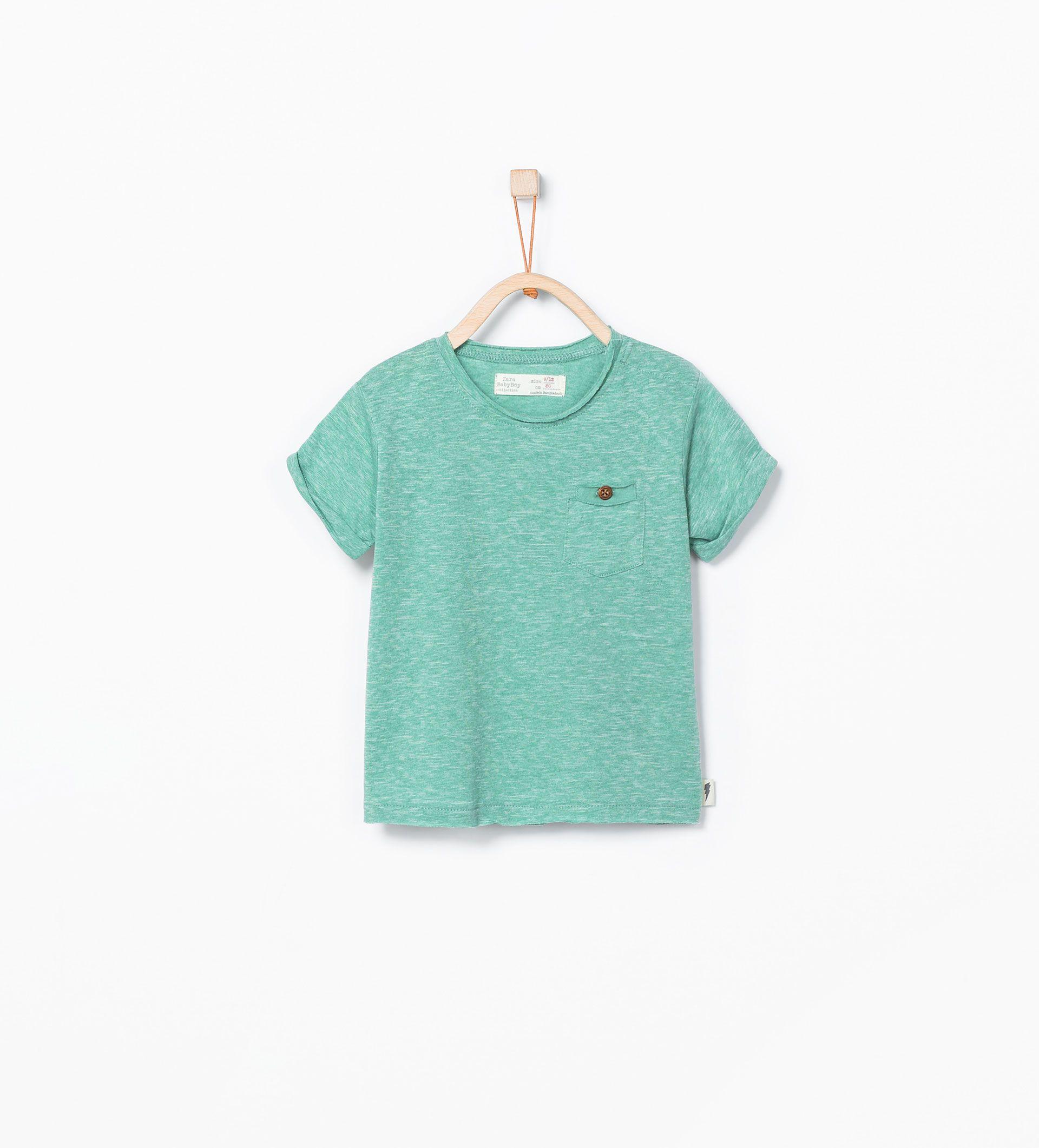 T Shirt mit doppelter Brusttasche und Zierknopf T
