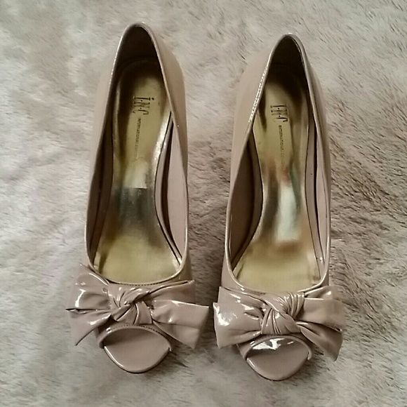 Nude Pump with Bow This shoes is the prefect nude shoe. Make a true fashion statement with these. Shoe is in Excellent condition. INC International Concepts Shoes