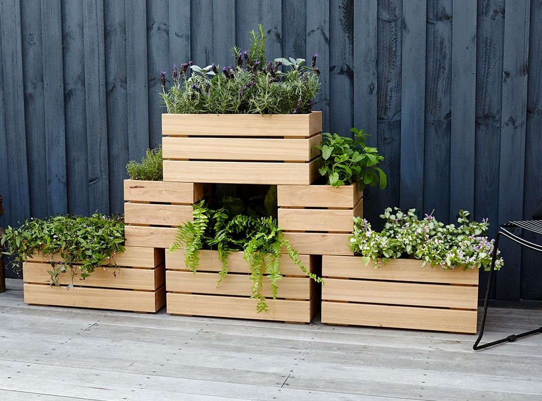 These wooden stackable planters are the perfect way to