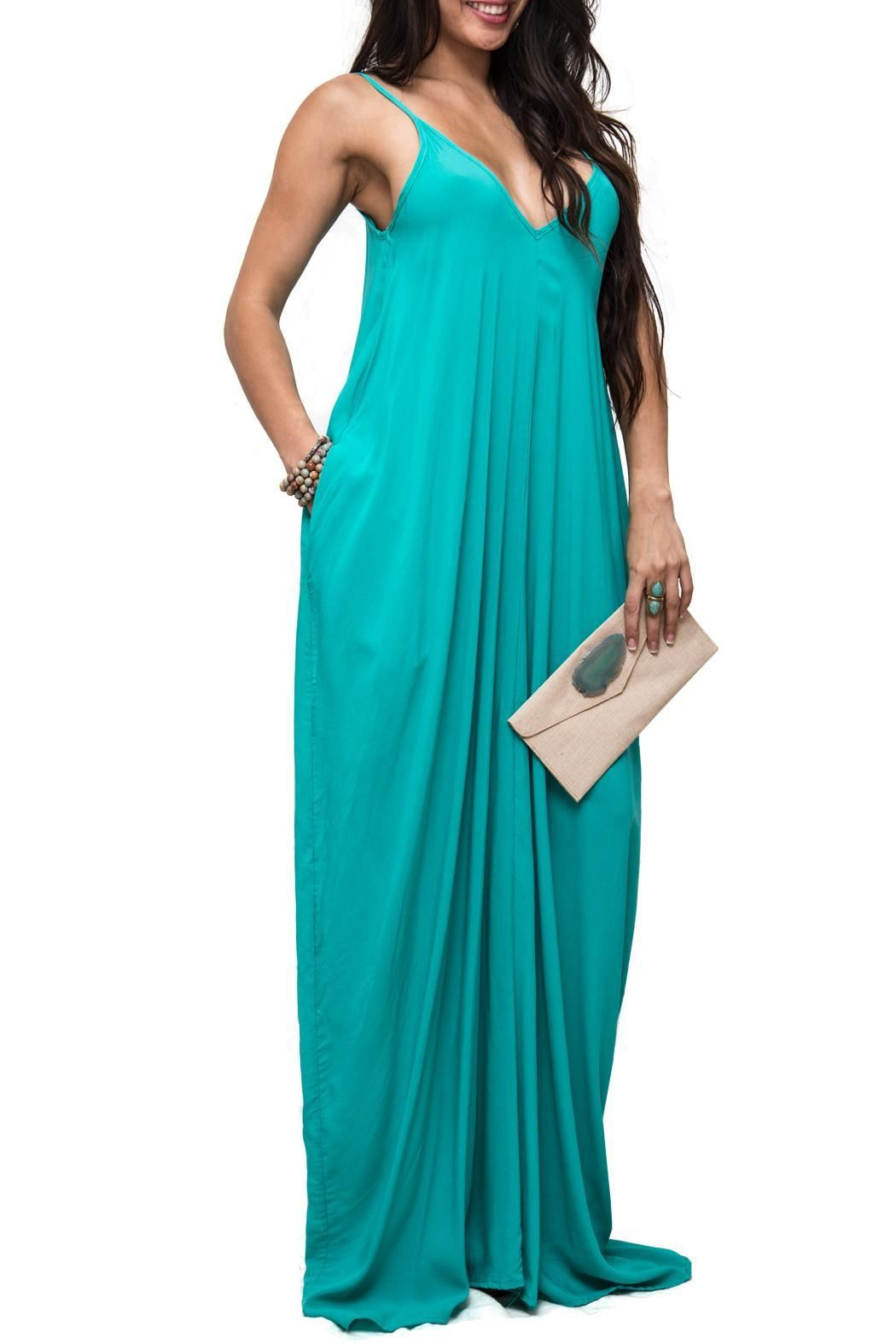 """Gorgeous maxi dress, with spaghetti straps and side pockets. The color is stunning and it simply just flows and compliments the body in all the right places. A definite stunner for the Bohemian chic chick. Whether on a tropical paradise or simply meeting the girls for brunch, this is the """"must have"""" piece.    Spaghetti Strap Maxi by Elan. Clothing - Dresses - Maxi Las Vegas"""