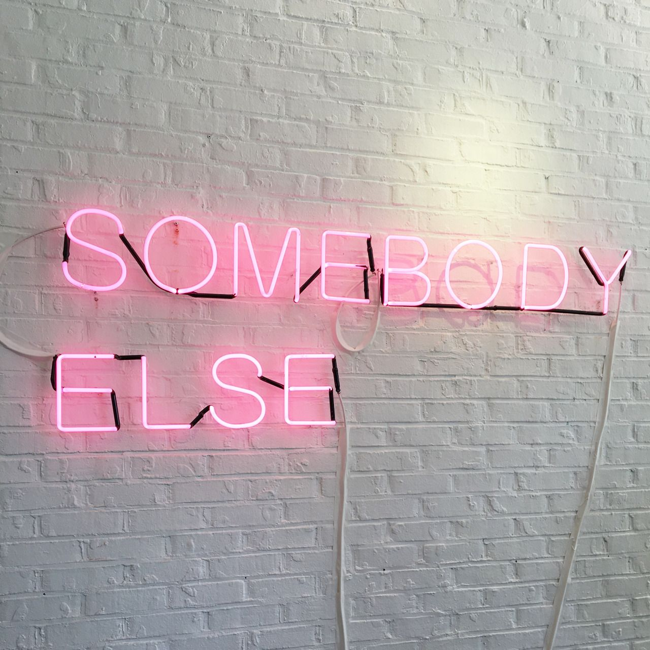 'Somebody else' Neon sign at The 1975 NYC Pop Up Shop