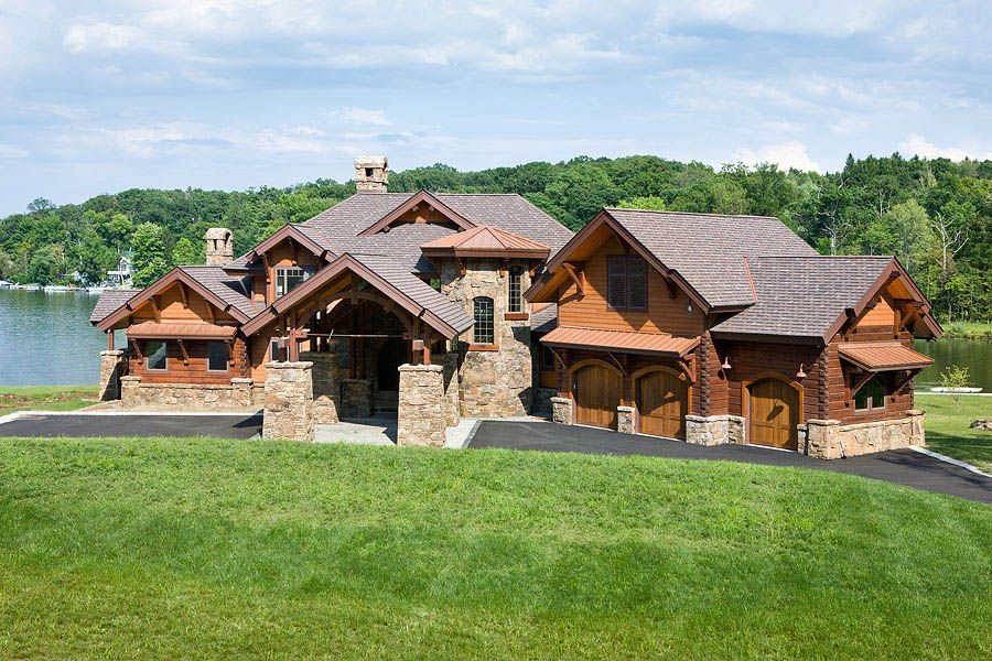 stone and log home plans. A combination of timber framing  siding and stone this hybrid New Jersey home