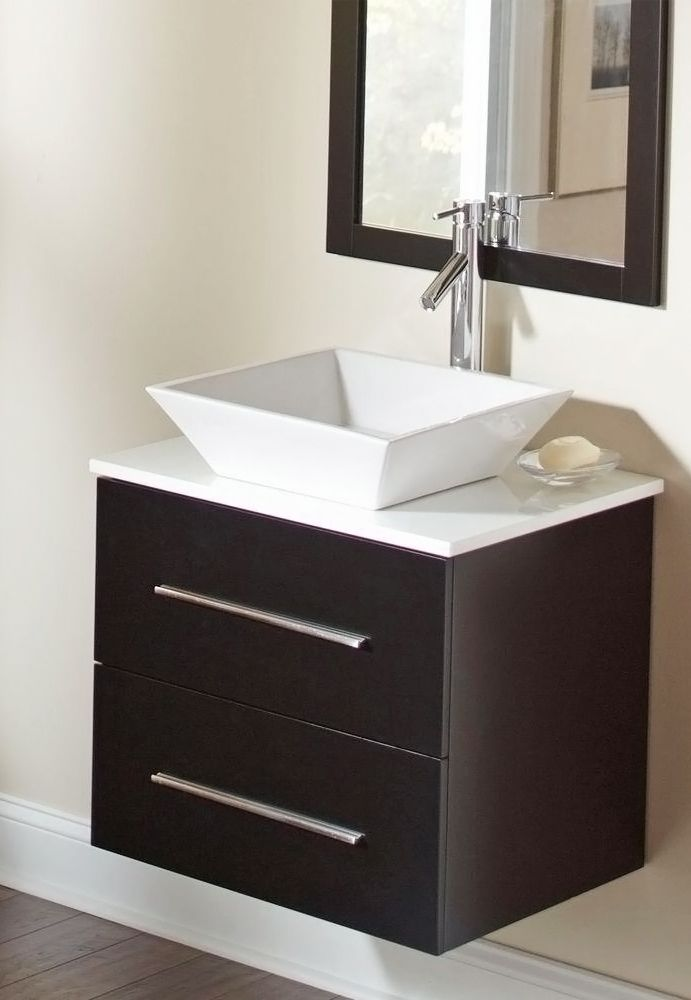 The floating vanity and square vessel sink give this bathroom combo