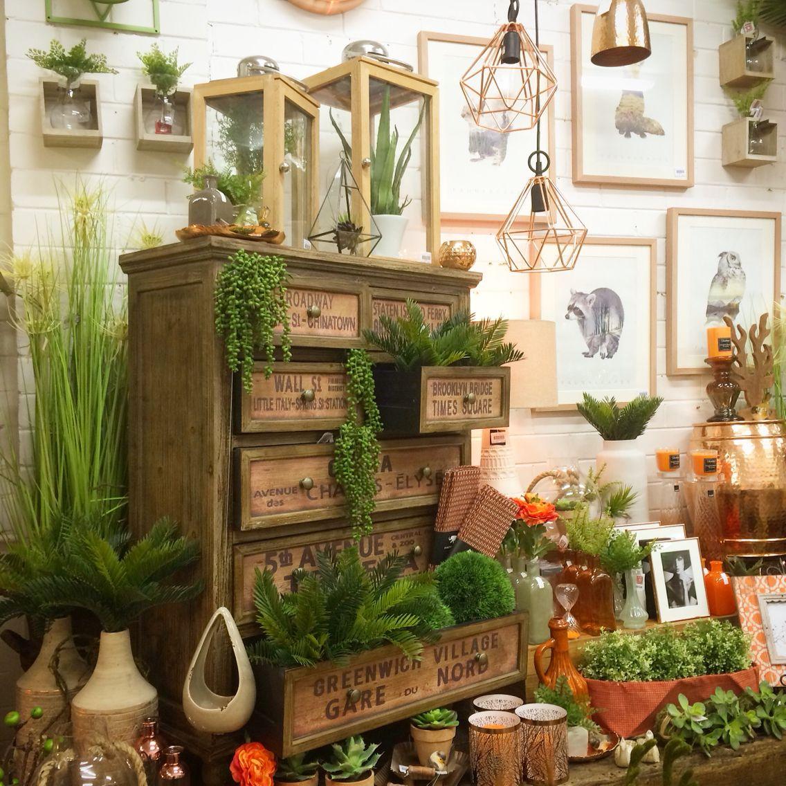 Orange and copper shop display. Home decor, interiors