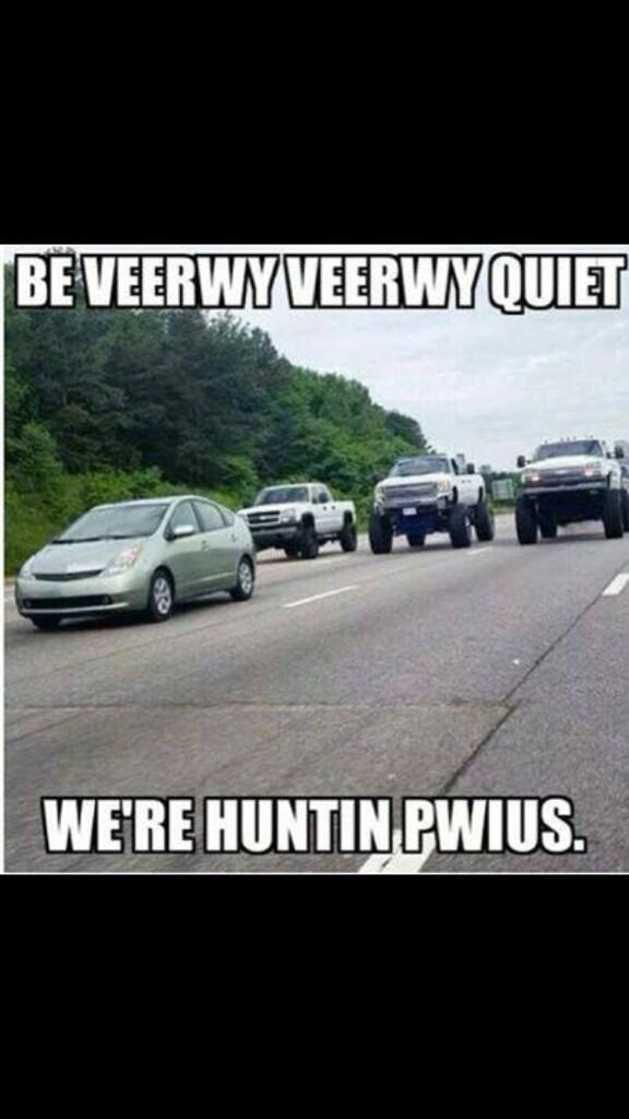 Hey little EPA Prius behind massive Chevy lifted trucks ...