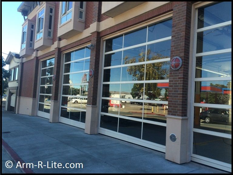 Perfect Adjacent Sloped Glass Garage Doors On A Fire Station In Sausalito, CA.  Welded Construction