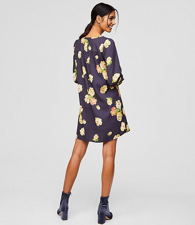 Just when this peony studded dress couldn't get any prettier a shirred back adds extra flow