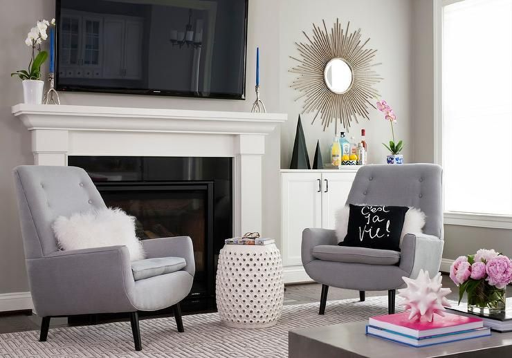 Chic Living Room Boasts A Pair Of Gray Tufted Accent Chairs